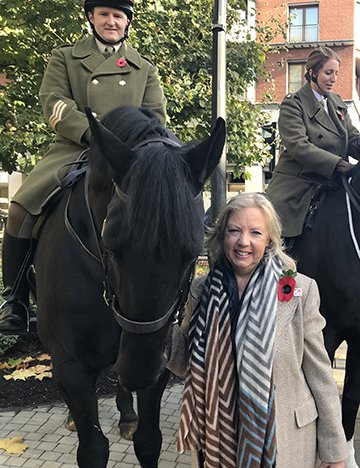 Deborah attends a service for animals lost in the war